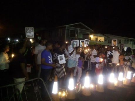 The families of the dead prisoners gathered outside of the Prison where they held the candlelight vigil for those who died   during the prison riot