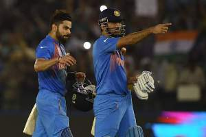 Virat Kohli and MS Dhoni put on an unbeaten stand of 67 runs for the fifth wicket to see India through to the semis of the WT20. © Getty
