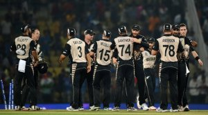New Zealand's players celebrate after winning. Photograph: Punit Paranjpe/AFP/Getty Images