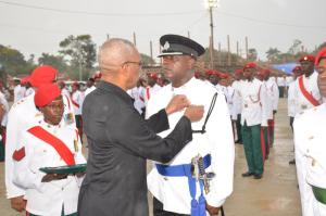 President David Granger, who is also Commander in Chief of the Armed forces, pins a medal to an officer of the Guyana Police Force's pocket, yesterday afternoon the Medal Presentation Parade.
