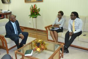 Monitoring and Evaluation Specialist and Head of the Project Management Office, Mr. Marlon Bristol and Head of the Office of Climate, Mrs. Janelle Christian during the meeting with Minister of State, Hon. Joseph Harmon.