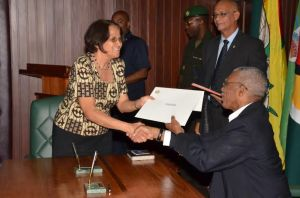Ms. Merle Mendonca accepts her Instrument of Appointment from President David Granger earlier this afternoon at the Ministry of the Presidency