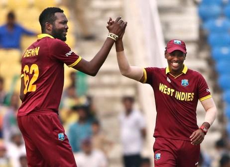 West Indies' Sulieman Benn, left, celebrates with Samuel Badree after taking the wicket of Afghanistan's Samiullah Shenwari during their ICC World Twenty20 2016 cricket match in Nagpur, India, Sunday, March 27, 2016.  (AP Photo/Saurabh Das)