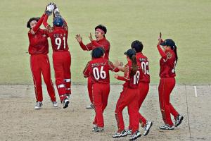 China women players celebrate the fall of a wicket in the 2014 Asian Games in Incheon. (Getty Images)