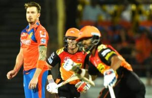 Gujarat Lions Dale Steyn (left) looks on as Sunrisers Hyderabad Captain David Warner (centre) and Shikhar Dhawan take a run during the 2016 Indian Premier League Twenty20 cricket match at the Saurashtra Cricket Association Stadium in Rajkot on April 21.INDRANIL MUKHERJEE