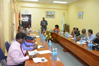 Minister of State, Mr.  Joseph Harmon addressing the preliminary meeting of the Board of Directors of the Guyana Lands and Surveys Commission, this afternoon in the Commission's boardroom.