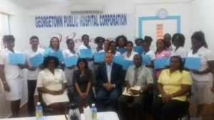 Public Health Minister, Dr. George Norton and GPHC staff pose with the 5th batch of Operating Room Technician Training Programme graduates.
