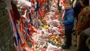 In the immediate aftermath, people from throughout Britain left tributes at Liverpool's Anfield stadium. Hide Caption