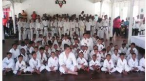 Ninth Dan Shuseki Shihan Frank Woon-A-Tai (centre, front row) with the students at the YMCA building