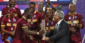 West Indies captain Darren Sammy (third left) accepts the trophy from Zaheer Abbas, the president of the International Cricket Council. Picture: Adnan Abidi