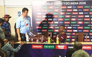 IMAGE: Marlon Samuels keeps his legs on the table at the post-match press conference of World T20 final.Photograph: Twitter.