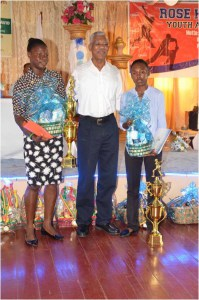 Champions! President David Granger with World Cup champions Shemaine Campbelle (right) and Tremayne Smartt