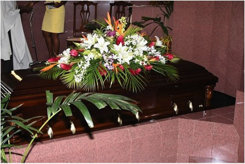 The body of the late Tony Cozier lies in the chapel of the Coral Ridge Memorial Gardens on Friday.