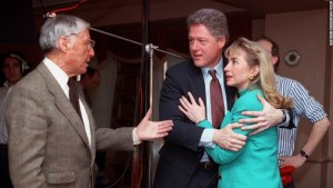 "Bill Clinton embraces his wife shortly after a stage light fell near her on January 26, 1992. They talk to Don Hewitt, producer of the CBS show ""60 Minutes."""