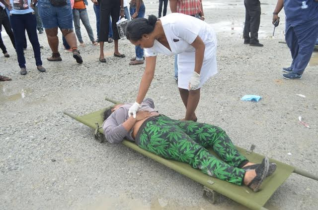 """A Nurse attending to a """"patient"""" during the CDC Mass Casualty Simulation Exercise at Durban Park"""
