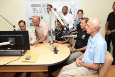 Prime Minister Moses Nagamootoo and Ministers Cathy Hughes, Ronald Bulkan and Sydney Allicock being interviewed in the studio of Radio Lethem (GINA Photo)