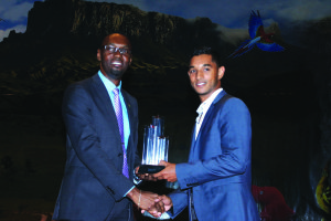 Kristian Jeffrey receiving his Sportsman of the year award from Director of Sports Christopher Jones