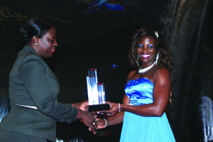 Minister Nicolette Henry presents Alicia Fortune with her Sportswoman of the year award