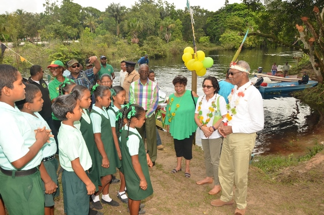 President Granger, First Lady, Mrs. Sandra Granger and Minister of Social Cohesion, Ms. Amna Ally enjoys a performance by the students of the St. Francis Primary School, who welcomed them with a song upon their arrival into the village. (GINA photo)