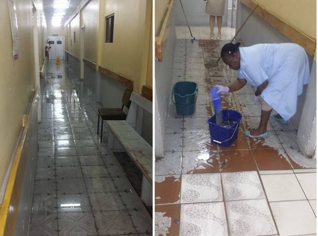 A woman is seen cleaning up the flooded areas at the Diamond Hospital this morning