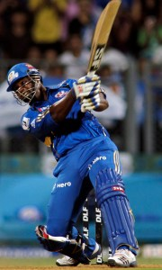Mumbai Indians' Dwayne Smith hits a four on the last ball of the match to win against Chennai Super Kings during an Indian Premier League (IPL) cricket match in Mumbai, India, Sunday, May 6, 2012. (AP Photo/ Rajanish Kakade)