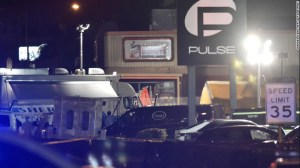 A van from a mortuary is seen in front of the Pulse club in Orlando, Florida, on June 12, as victims' bodies are removed from the scene of the mass shooting.