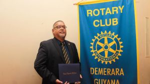 Veteran Guyanese Business Executive Ramesh Dookhoo with his prestigious Paul Harris Fellow Award