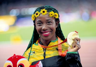Shelly-Ann Fraser-Pryce displays her gold medal during the medal presentation ceremony after winning the 100m at the 2015 IAAF World Athletics Championships in Beijing, China. (Photo: Jamaica Observer)