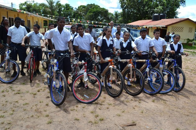 Some of the recipients display their brand new bicycles, which were donated under President David Granger's 'Five Bs' or 'Boats, Buses, Bicycles plus Breakfast and Books' Programme. (GINA photo)