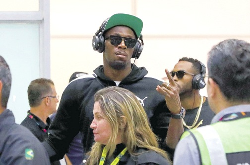 Bolt upon his arrival in Rio paused for photos from waiting media, he did not give any interviews and eventually left in a private car. (Photo: AP)