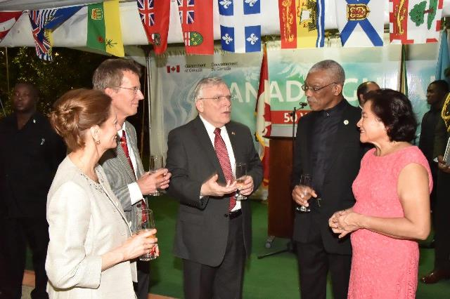 President David Granger and First Lady, Mrs. Sandra Granger in conversation with Canadian High Commissioner Mr. Pierre Giroux (at centre) and his wife Mrs. Blanca Giroux and Head of Aid, Mr. Daniel Joly on the occasion of Canada Day. (GINA photo)