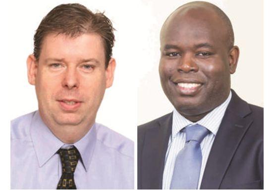 CEOs of Digicel Kevin Kelly (L) and GTT Justin Nedd