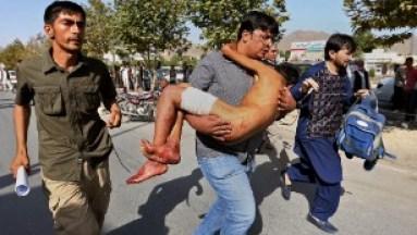 A man carries a boy injured in an explosion in Kabul. (CNN photo)