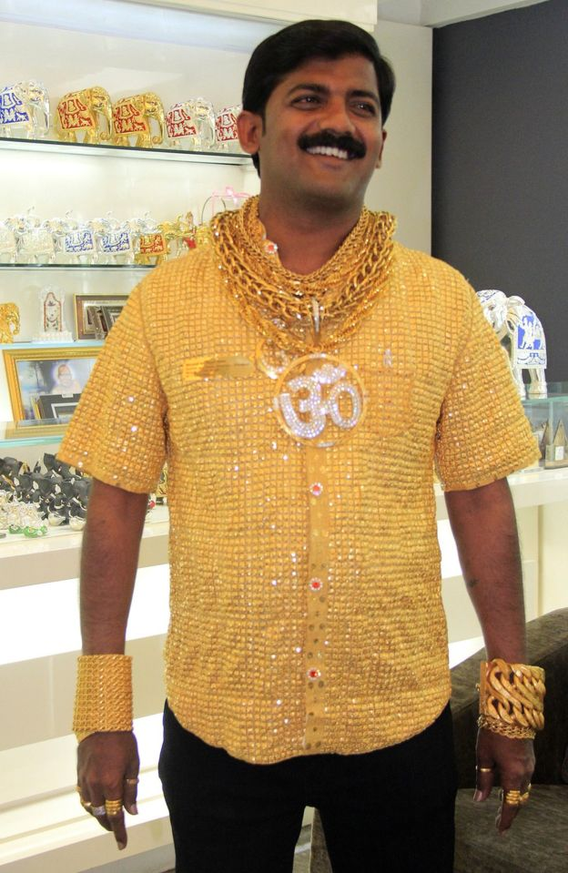 Mr Phuge often wore gold all over his body (AFP photo)