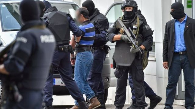 A suspected member of the Islamic state group is led away by Austrian police (AFP photo)