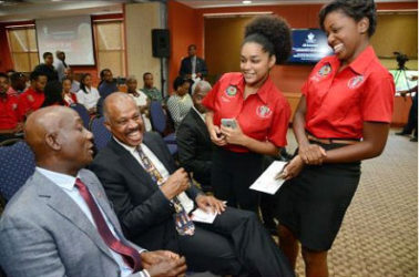 Dr Keith Rowley (left), Prime Minister of Trinidad and Tobago, and Professor Sir Hilary Beckles, Vice Chancellor of the University of the West Indies, chat with Kennika Johnson (second right), Secretary of the Guild of Students, and Sherica Taylor, Public Relations Officer, Guild of Students. (Jamaica Gleaner photo)