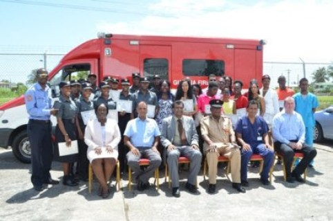 Graduates of the Emergency Medical Technician (EMT) course. Seated in front (L-R) are Ministry of Public Security's Permanent Secretary, Danielle McCalmon, Director of Medical and Professional Services at the GPHC, Dr. Sheik Amir, Public Security Minister Khemraj Ramjattan, Fire Chief, Marlon Gentle, National Emergency Medical Director Dr Zulficar Bux and Vanderbilt University Representative, Dr Shannon Langston (GINA photo)