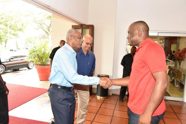 President David Granger exchanges a handshake with Prime Minister Roosevelt Skerrit upon his arrival at the Pegasus Hotel, this morning, for a Breakfast meeting. (GINA photo)