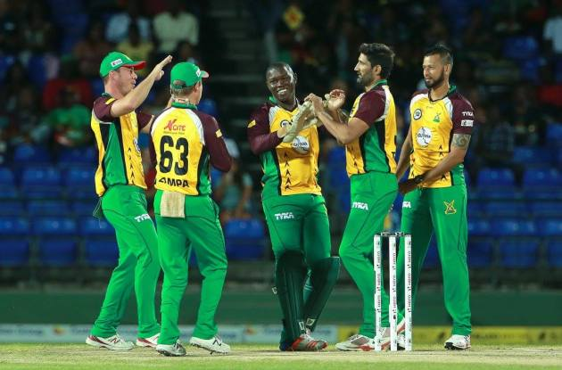 Sohail Tanvir, second from right, and the Guyana Amazon Warriors celebrate the wicket of Lendl Simmons during Match 2 of the Hero Caribbean Premier League between St Kitts & Nevis Patriots and Guyana Amazon Warriors at Warner Park in Basseterre, St Kitts. (CPL Photo by Ashley Allen/Sportsfile)