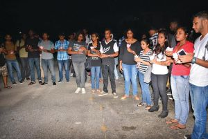 Friends of drowned UG student during the candle-lit vigil