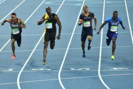 (From left) Canada's Andre De Grasse, Jamaica's Usain Bolt, France's Jimmy Vicaut and USA's Justin Gatlin cross the finish line of the Men's 100m Final during the athletics event at the Rio 2016 Olympic Games at the Olympic Stadium in Rio de Janeiro yesterday. (JEWEL SAMAD)