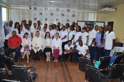 The batch of sixth year medical students pose for a photo with the Cuban Medical Brigade
