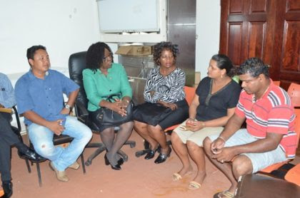 From left to right; Regional Health Officer Region Nine, Dr. Ronald Chowdry, Minister within the Ministry of Public Health Dr. Karen Cummings, Director of Regional Health Services Dr. Kay Shako, (mother of stillborn baby ) Christina Teloki, and a family member.