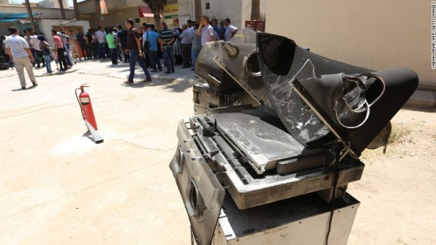 Burned incubators stand outside Baghdad's Yarmouk hospital Wednesday after a deadly fire. (CNN photo)