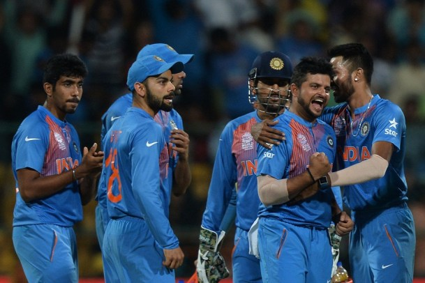 India's bowler Suresh Raina(2R)celebrates with teammates after taking the wicket of Bangladesh batsman Sabbir Rahman during the World T20 cricket tournament match between India and Bangladesh at The Chinnaswamy Stadium in Bangalore on March 23, 2016.  Bangladesh is chasing a target of 146 runs scored by India with a loss of 7 wickets. / AFP / MANJUNATH KIRAN        (Photo credit should read MANJUNATH KIRAN/AFP/Getty Images)