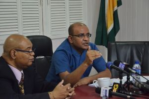Opposition Leader, Dr Bharrat Jagdeo addressing members of the Media today. Also in photo is former Government Minister Bishop Juan Edghill