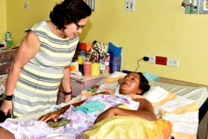First Lady, Mrs. Sandra Granger comforts Ms. Ophelia James during a visit with her, this morning, at the Georgetown Public Hospital Corporation. (GINA photo)