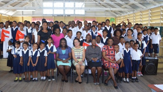 First Lady, Mrs. Sandra Granger (seated, second left) along with the teachers and students at the opening of the  Youth Development Initiative at the Lusignan Primary School.
