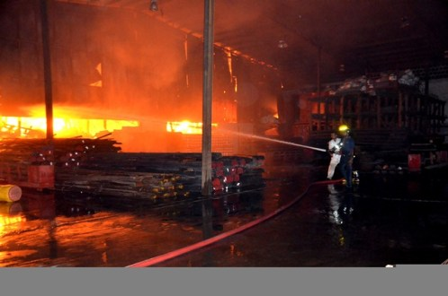 Firemen trying to battle the blaze