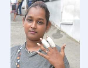 Chopped across the fingers, Nadia Hosein outside the San Fernando Magistrates' Court on Thursday. (Photo: Dave Persad)